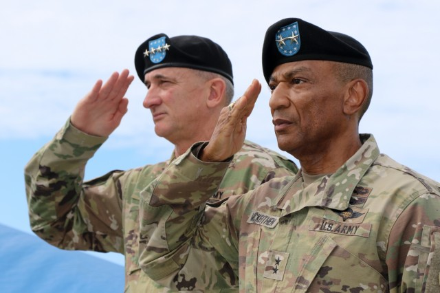 FORT SHAFTER, HI--Maj. Gen. Timothy M. McKeithen, (right) deputy commanding general- National Guard, USARPAC, and Gen. Robert B. Brown, USARPAC commanding general, salute the colors during a Flying V ceremony held at historic Palm Circle, Fort Shafter, Hawaii, March 15. The Flying V ceremony traditionally welcomes or honors senior Army officials when they assume duties or depart from an USARPAC. The V refers to the way the colors are posted during the ceremony, which is V-shaped.