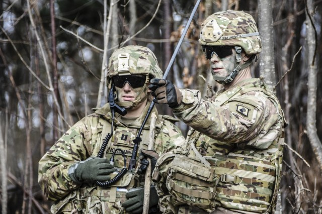 Capt. Beverly Nordin and Command Sgt. Maj. James LaFratta, the 173rd Airborne Brigade Support Battalion operations officer and command sergeant Major, make decisions about the employment of heavy machine guns as their paratroopers conduct a base defense live fire in Slovenia.
