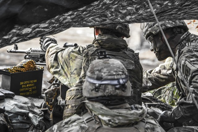 A machine gunner points out his intended targets to the 173rd Airborne Brigade commander as the Brigade Support Battalion conducts base defense live fire training in Slovenia.