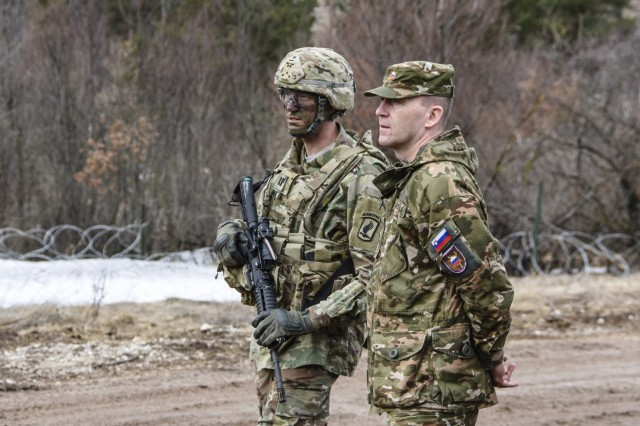 Leadership from the Slovenian Army discuss training with leaders from the American 173rd Airborne Brigade as the paratroopers train on Base Defense Live Fire at the Postojna, Slovenia training area.