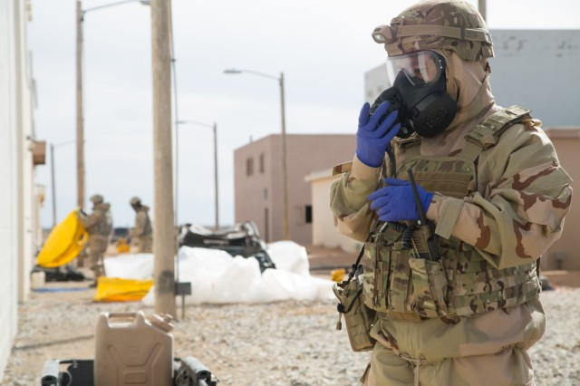 A United States Soldier, assigned to the 48th Chemical Brigade, radios in a report after inspecting a building for simulated potentially harmful agents during the 48th Chemical Brigade Chemical Response Team (CRT) Validation Exercise at Fort Bliss, Texas, Feb. 13, 2018. The validation exercise measures CRTs ability to effectively execute their tasks through realistic training. (U.S. Army photo by Sgt. Quince Lanford)