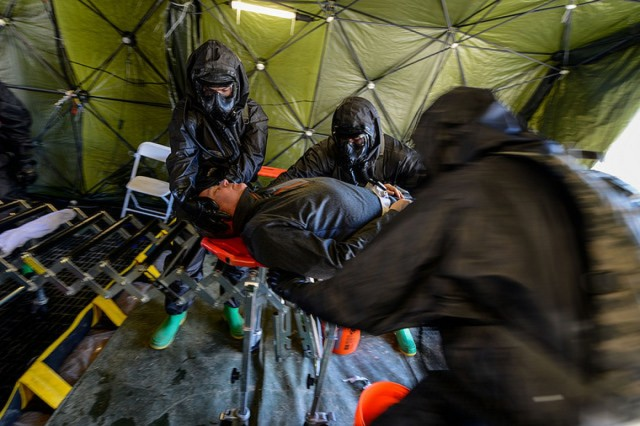 U.S. Soldiers from the 251st Area Support Medical Company, South Carolina Army National Guard, and the 231st Chemical Company, Maryland Army National Guard, are evaluated by ARNORTH on their equipment setup time and proper decontamination and triaging at Clarks Hill Training Center, S.C., March 9, 2018.