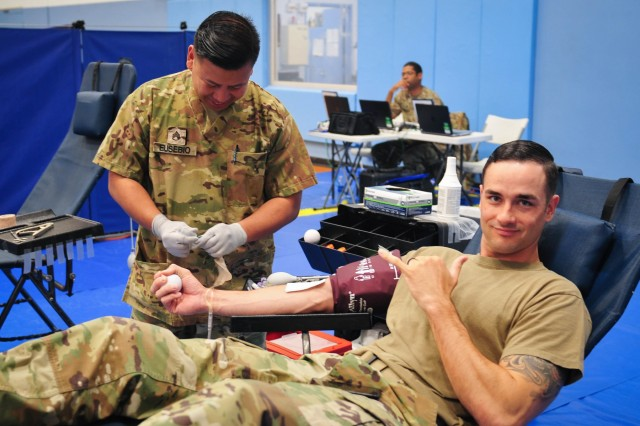 Sgt. Steven Faisst, a military policeman with the 8th Theater Sustainment Command, has his blood drawn during a blood drive sponsored by the 8th Theater Sustainment Command and Armed Services Blood Program (ASBP) at Fort Shafter, Hawaii. With the blood drive, the 8th TSC and ASBP sought to provide quality blood products for service members, veterans and their families in both peace and war. In particular, the blood drive supported the U.S. Army's top priority of readiness by ensuring Soldiers have the tools they need to deploy, fight, and win across the entire spectrum of conflict.  (U.S. Army photo by Sgt. 1st Class Michael Behlin)