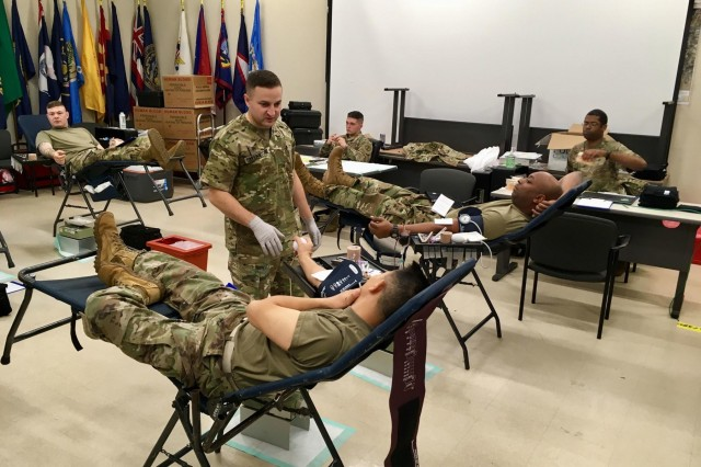 Soldiers stationed at Schofield Barracks give blood during a drive sponsored by the 8th Theater Sustainment Command and Armed Services Blood Program (ASBP) March 9 at the 130th Engineer Brigade's headquarters. With the blood drive, the 8th TSC and ASBP sought to provide quality blood products for service members, veterans and their families in both peace and war. In particular, the blood drive supported the U.S. Army's top priority of readiness by ensuring Soldiers have the tools they need to deploy, fight, and win across the entire spectrum of conflict.  (U.S. Army photo by Maj. Lindsey Elder)