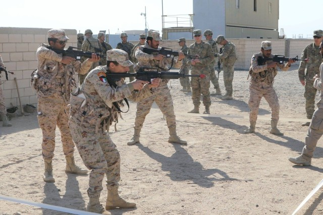 Iron Soldiers embrace international interoperability as they partnered and conduct training with the Kuwaiti Land Forces. Soldiers with the 1st Battalion, 35th Armored Regiment, showed an array of skills from clearing rooms and urban defense to squad attack in order to minimize the effects of the enemy's defensive fires during movement. (U.S. Army photo by Staff Sgt. Adriana M. Diaz-Brown, 2nd Armored Brigade Combat Team)