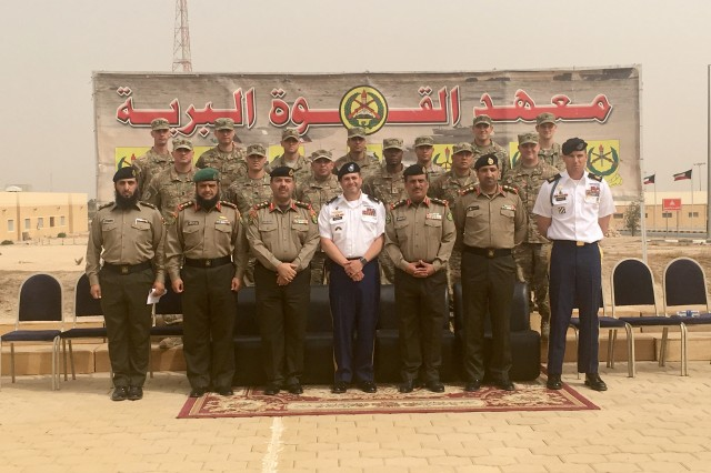 Soldiers and leaders with the 1st Battalion, 35th Armored Regiment joined leaders with the Kuwaiti Land Forces Institute for a photo Feb. 22 after a graduation ceremony at the Kuwaiti Land Forces Institute. The first of its kind as a joint partnership with the KFLI students to enhance interoperability among U.S. forces and their partners. (U.S. Army phot by Staff Sgt. Adriana M. Diaz-Brown, 2nd Armored Brigade Combat Team)