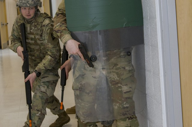 U.S. Army Spc. David DeLong, 172nd Law Enforcement Detachment, Garrison Support Command, Vermont National Guard, moves to open a door during a simulated active shooter scenario at the Vermont National Guard Readiness and Regional Technology Center in Northfield, Vt., March 3, 2018. The 172nd LED completed a culminating exercise that used several scenarios to address their new focus on law enforcement since reorganizing from a combative role.