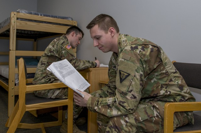 U.S. Army Sgt. Jay Atherton, left, a team leader, 172nd Law Enforcement Detachment, Garrison Support Command, Vermont National Guard, interviews Spc. Jaimee Boivin, who is acting as a witness, during a simulated investigation scenario at the Vermont National Guard Readiness and Regional Technology Center in Northfield, Vt., March 3, 2018. The 172nd LED completed a culminating exercise that used several scenarios to address their new focus on law enforcement since reorganizing from a combative role.