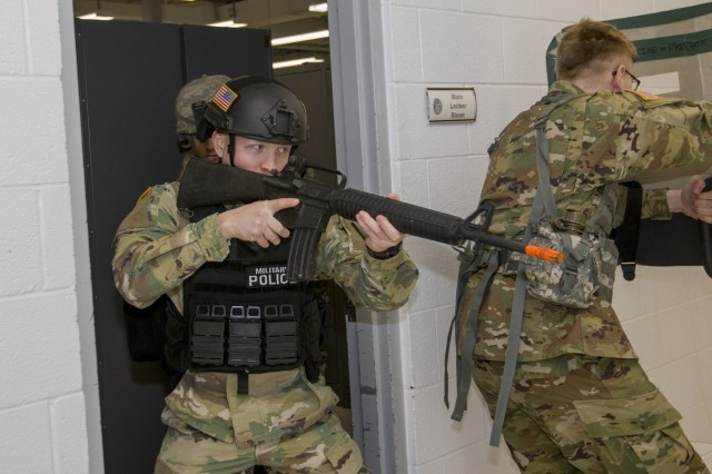 U.S. Army Spc. David DeLong, 172nd Law Enforcement Detachment, Garrison Support Command, Vermont National Guard, enters a hallway with his team during a simulated active shooter scenario at the Vermont National Guard Readiness and Regional Technology Center in Northfield, Vt., March 3, 2018. The 172nd LED completed a culminating exercise that used several scenarios to address their new focus on law enforcement since reorganizing from a combative role.