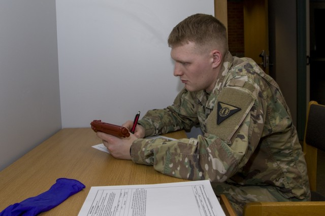 U.S. Army Spc. David DeLong, 172nd Law Enforcement Detachment, Garrison Support Command, Vermont National Guard, records evidence during a simulated investigation scenario at the Vermont National Guard Readiness and Regional Technology Center in Northfield, Vt., March 3, 2018. The 172nd LED completed a culminating exercise that used several scenarios to address their new focus on law enforcement since reorganizing from a combative role.