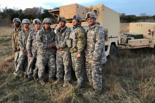 Soldiers with the Geospatial Intelligence Platoon, 303rd Military Intelligence Battalion, 504th Military Intelligence Brigade pose for a group picture during a fall training exercise with the 3rd Cavalry Regiment at Fort Hood.