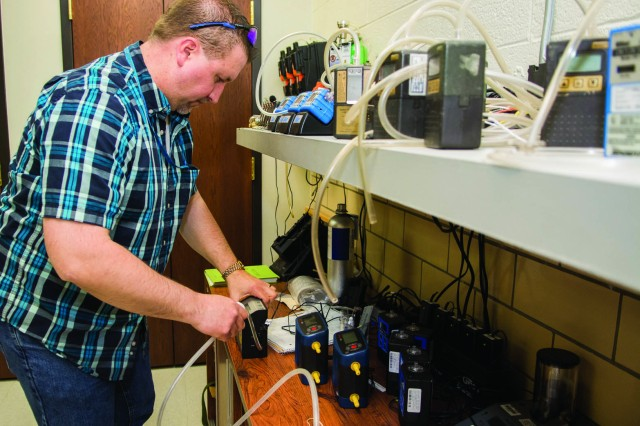 Frank Jurkiewic, an industrial hygiene technician at Tobyhanna Army Depot, verifies sampling and testing equipment are ready for field service.
