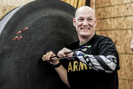 Command Sgt. Major Matthew Unger, assigned to the Warrior Transition Unit, retrieves his arrows during archery training for the Army Trials at Fort Bliss, Texas, Feb. 27, 2018. Seventy four wounded, ill or injured active duty Soldiers and veterans participate in a series of events that are held at Fort Bliss, Texas, Feb. 27, through Mar. 9, 2018, as the Deputy Chief of Staff, Warrior Care and Transition hosts the 2018 U.S. Army Trials.