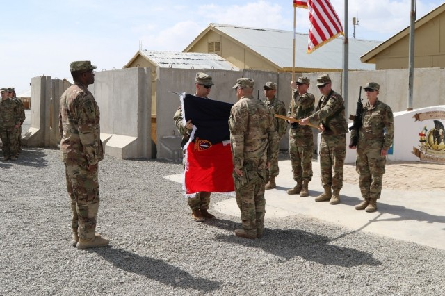 The 1st Security Force Assistance Brigade command team, Col. Scott Jackson, left center, and Cmd. Sgt. Maj. Christopher Gunn, right center, uncase the unit's colors on Advisor Platform Lightning, March 15, 2018. Brig. Gen. David Hamilton, Task Force Southeast Commander, left, presided over the ceremony. The 1st SFAB and its six battalions uncased their colors across Afghanistan, symbolically beginning their mission to train, advise and assist the Afghan National Defense Security Forces.