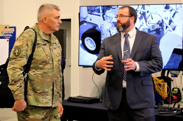 Maj. Gen. Peter A. Gallagher, director of Architecture, Operations, Networks and Space in the Office of the Chief Information Officer/G-6 and now the network C3I cross-functional team lead under the Army's Futures Command, discusses CERDEC's Expeditionary Command Post Capability technologies Nov. 14 with Tyler Barton at Aberdeen Proving Ground. Gallagher also toured CERDEC's C4ISR Prototype Integration Facility, which is responsible for rapidly developing and integrating expeditionary mission command technologies for Soldier evaluation.