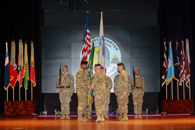 FORT BENNING, Ga. (March 19, 2018) -- Lt. Gen. Michael D. Lundy, commanding general of the Combined Arms Center at Fort Leavenworth, Kansas, passes the Maneuver Center of Excellence and Fort Benning colors to Maj. Gen. Gary M. Brito, the new commander of the MCoE and Fort Benning. The Maneuver Center of Excellence and Fort Benning welcomed Brito during a change of command ceremony March 19 at Fort Benning, Georgia. Brito received the MCoE and Fort Benning colors, signifying his assumption of command, from Maj. Gen. Eric J. Wesley, the outgoing MCoE commander. (U.S. Army photo by Markeith Horace, Maneuver Center of Excellence, Fort Benning Public Affairs)