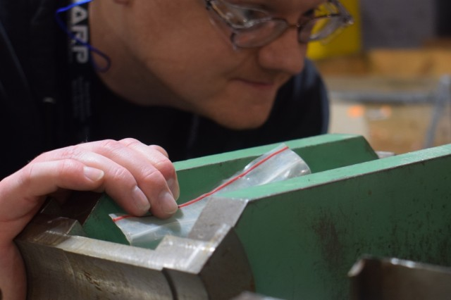 Crane Army Ammunition Activity employee Evan Prichard inspects equipment during operations. Crane Army Ammunition Activity provides conventional munitions support for U.S. Army and Joint Force readiness including production, demilitarization, transportation and storage.