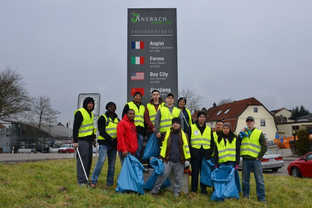 ANSBACH, Germany -- Soldiers and Family members of the Ansbach community pause from picking up trash along the road leading from Katterbach to Ansbach. The city of Ansbach holds a city-wide cleanup annually called the Ansbach Saub(ä)er. During this year's Saub(ä)er, March 17, 2018, more than 200 Soldiers, Family members and U.S. Civilians spent the Saturday morning walking along the roads that surround the kasernes to pick up litter.