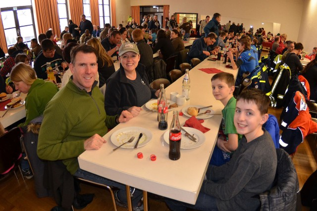 ANSBACH, Germany -- Members of the U.S. Army Garrison Ansbach (USAG Ansbach), the 12th Combat Aviation Brigade (12th CAB), joined by Soldiers of the 1st Air Cavalry Brigade (1 ACB) and 678th Air Defense Artillery Brigade (678th ADA) enjoy a hot meal and fellowship with German neighbors after taking part in the Ansbach Cleanup Day March 17, around USAG Ansbach posts. The city of Ansbach holds a city-wide cleanup annually called the Ansbach Saub(ä)er. During this year's event, more than 200 Soldiers, Family members and USAG Ansbach Civilian employees participated in the cleanup. The city of Ansbach arranged and sponsored a free catered hot lunch for all participants at theEyb Distlersaal (community center) where many attending Soldiers enjoyed Franconian specialties and spoke with some of the citizens whose towns, parks and sidewalks they had together helped to clean up.