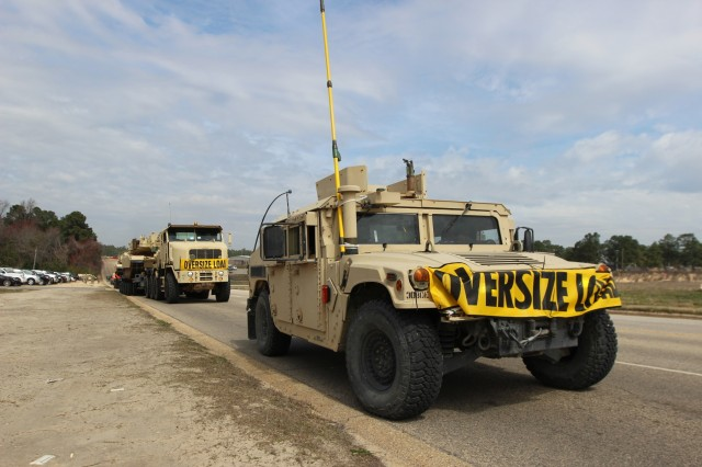 North Carolina National Guard soldiers with the 1452nd Heavy Equipment Transportation Company, 113th Sustainment Brigade, line up M1070 Heavy Equipment Transporter vehicles for their convoy to Fort Pickett, Virginia on Mar. 17, 2018. The vehicles will be transporting M1A1 Abrams tanks and Bradley Fighting Vehicles to Fort Pickett, Virginia, to be used by the 30th Armored Brigade Combat Team during gunnery, in preparation for the 30th ABCT upcoming eXportable Combat Training Capability (XCTC) training.