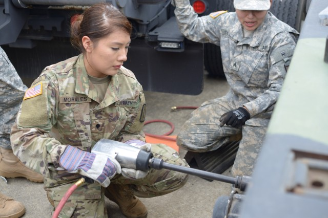 North Carolina National Guard soldier, Spc. Alondra Morales, with the 1452nd Heavy Equipment Transportation Company, 113th Sustainment Brigade, removes a flat tire from a M1000 trailer using an air impact gun, at Fort Bragg, North Carolina, on Mar. 17, 2018. The unit is using the trailer to transport a M1A1 Abrams tank to Fort Pickett, Virginia, in support of the 30th Armored Brigade Combat Team gunnery, in preparation for the 30th ABCT upcoming eXportable Combat Training Capability (XCTC) training at Fort Bliss, Texas.