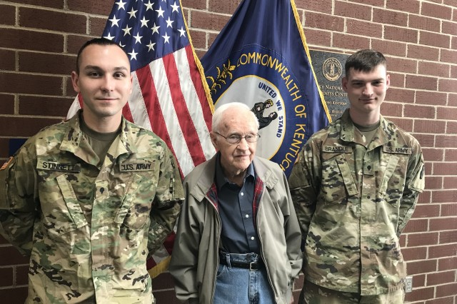 Spc. Justin Stinnett (left) and Spc. Casey Brandle (far right) share a photo op with David Hamilton in Owensboro, Ky., March 19, 2018. Stinnett and Brandle are credited with saving Hamilton from an auto accident in flood waters in Owensboro Feb. 27.