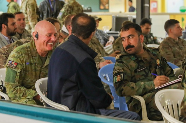 Leaders from Afghanistan interact with each other, March 19, 2018, during a Humanitarian Assistance/Disaster Response exercise in Kandahar, Afghanistan. The exercise, which was hosted by Resolute Support-Headquarters and leaders from Train, Advice, Assist Command-South was conducted to assist Afghan leaders to refine and improve their national and regional level HA/DR contingency plans.