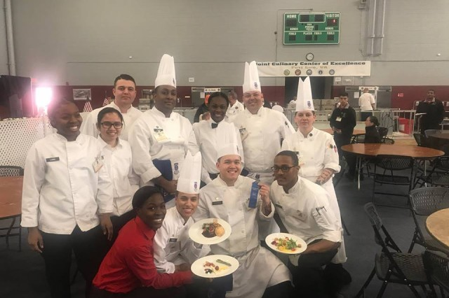 Members of the Fort Drum Culinary Arts Team show off their award-winning plates after the Professional Chef Team earned a gold medal in the Hot Foot Kitchen category at the 43rd Joint Culinary Training Exercise at Fort Lee, Va. (Photo Courtesy of the Advanced Food Service Training Division)