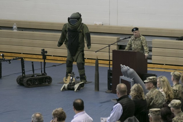 Col. Mark R. Faria, former commander of the 52nd Ordnance Group (EOD), 20th Chemical, Biological, Radiological, Nuclear and high-yield Explosive Command, speaks to the Soldiers, friends and families of the unit during a change of command ceremony in Sabo Physical Fitness Center on Fort Campbell, Ky., Mar. 14, 2018. Faria reflected on his time in command and highlighted the achievements of the Soldiers in his care.