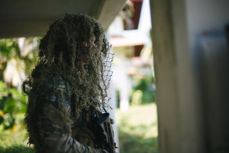 A U.S. Army Special Forces sniper observes a U.S. and Panamanian security forces exercise Feb. 1, 2018, after completing reconnaissance training in Colon, Panama. The exercise culminated a month-long training exchange between participating countries.