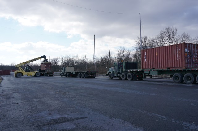 A Letterkenny Munitions Center employees unload shipping containers from the 1048th Transportation Company, Connecticut Army National Guard's flatbed trailers in support of Operation Patriot Bandoleer.