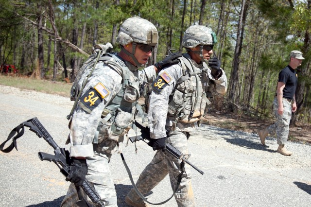 FORT BENNING, Ga. (March 20, 2018) -- In this U.S. Army file photo, two Soldiers take part in a road march at Fort Benning, Georgia. Training outdoors comes with a risk of heat injury, and a team of doctors at the Martin Army Community Hospital at Fort Benning are working on ways to prevent heat-related deaths across the Department of Defense by establishing a heat center on post. (U.S. Army file photo by Markeith Horace, Maneuver Center of Excellence, Fort Benning Public Affairs)