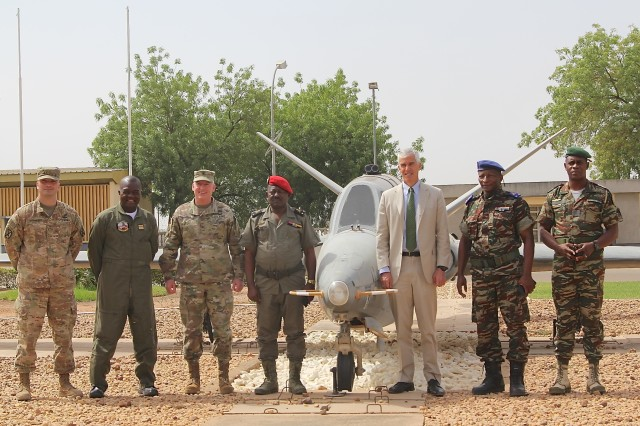 Peter Barlerin, United States Ambassador to Cameroon and Brig. Gen. Eugene J. LeBoeuf acting commanding general for U.S. Army Africa, visit Contingency Location Garoua, Cameroon March 15 and pose for a photo with Cameroonian Military leaders. Barlerin and LeBoeuf later visit the Garoua Regional Hopital where the USARAF Medical Readiness Training Exercise Team assist with medical expertise. TF Darby serve members at CL Garoua, are serving in a support role for the Cameroonian Military's fight against the violent extremist organization Boko Haram.