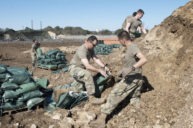 Maj. Jeffry Beeman, Senior Engineer for the 13th ESC fills sand bags with Soldiers for the bunker and fighting positions during the CPX-F-18 at Camp Bowie in Brownwood, Texas on February 28, 2018.