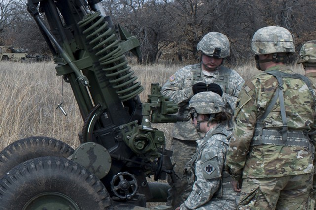 Cpl. Lynda Steele, a gunner with 1st Battalion, 160th Field Artillery, 45th Infantry Brigade Combat Team, Oklahoma Army National Guard, prepares her 105mm Howitzer to fire during a live fire exercise at Fort Sill, Oklahoma. Members of the 1st Battalion, 160th Field Artillery, conducted a live fire exercise at Fort Sill, Oklahoma, on March 2-4, 2018. This exercise marks the last time the 160th will fire the M119 A2 105mm Howitzer before they transition to the new M119 A3 later this year.