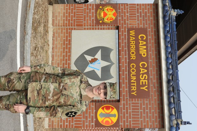 2nd Lt. Sarah Casey, native of Collierville, Tenn., assigned to 6th Battalion, 37th Field Artillery Regiment, 210th Field Artillery Brigade, stands in front of the Camp Casey sign honoring her great uncle Maj. Hugh B. Casey, a World War II veteran killed during the Korean War. Camp Casey was named in his honor after Maj. Casey's plane crashed over the camp in 1952 during the war. 2nd Lt. Casey honors her great uncle by serving as a field artillery officer at the same camp 66 years later. (U.S. Army photo by Spc. Sarah Williams, 2nd Infantry Division/ROK-US Combined Division Public Affairs Office)