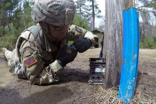 An infantryman with the 165th Infantry Brigade, pulls the pin on a grenade during Expert Infantryman Badge testing March 20 on Fort Jackson. Infantrymen from across the installation, and some as far away as Fort Irwin, Calif., tested March 19-23 to earn the coveted sikill badge.