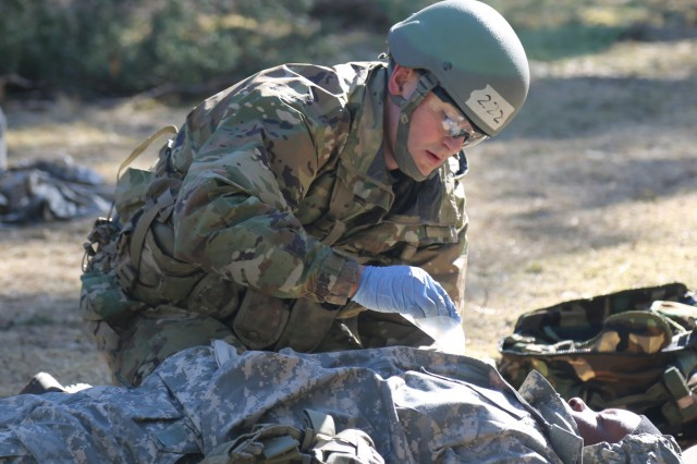 Spc. Matthew Holtz, medic from with 1st Battalion-503rd Infantry Regiment, 173rd Airborne Brigade, treats a penetrating chest wound on a simulated casualty, during U.S. Army Europe's Spring 2018 Expert Field Medical Badge testing, March 20, in Grafenwoehr, Germany. Holtz went on to be recognized as the honor graduate for the testing.