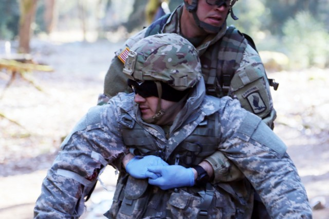 1st Lt. Zakary Hartford, squadron medical officer with 173rd Airborne Brigade, performs a one-person drag, during the U.S. Army Europe Spring 2018 Expert Field Medical Badge testing, March 20, in Grafenwoehr, Germany.