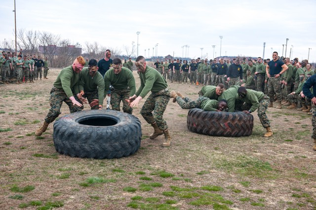 Marines compete in the tire-flip event of the detachment's annual Engineer Equipment Instruction Company St. Patrick's Day Engineer Field Meet. The games are held each year on Fort Leonard Wood in celebration of the Marine Corps' Engineer birthday and in honor of Saint Patrick, the patron saint of engineers.