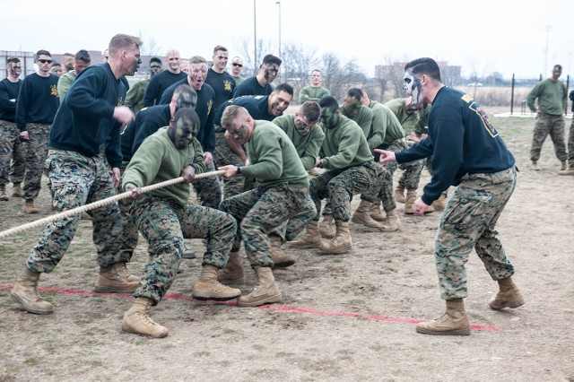 Marines compete in the tug-of-war event of the detachment's annual Engineer Equipment Instruction Company St. Patrick's Day Engineer Field Meet. The games are held each year on Fort Leonard Wood in celebration of the Marine Corps' Engineer birthday and in honor of Saint Patrick, the patron saint of engineers.