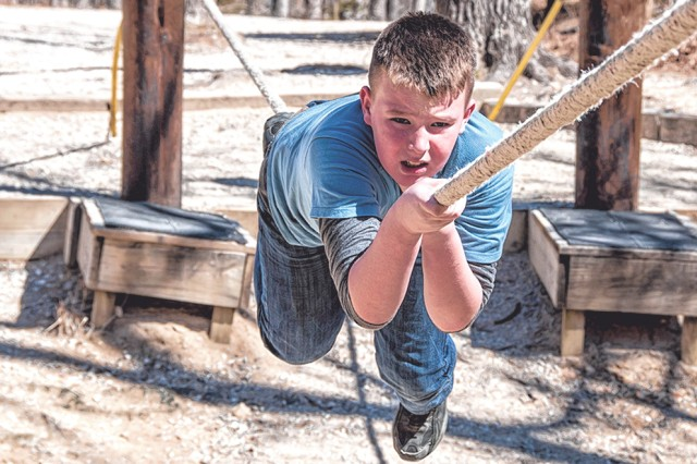 Landon Cox, a Boy Scout from Troop 1890, navigates an obstacle during a March 15 installation visit.