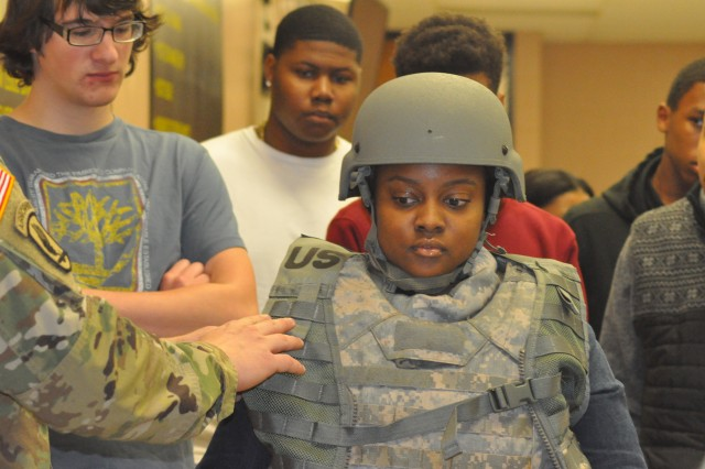 A student from Lee Central High School's Job Readiness Training program tries on a helmet and body armor during a visit of the 120th Adjutant General Battalion on the Come Meet your Army Tour March 16.
