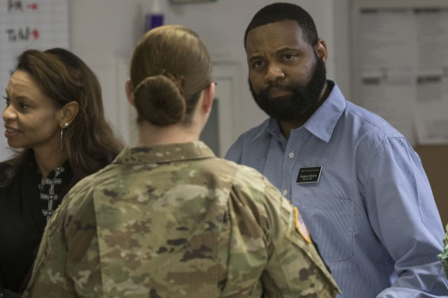 Damien Johnson, with the Fort Jackson Military and Family Life Counselors, speaks to a Soldier March 19 at the Reception Medical Clinic during a Holistic Soldier Readiness Processing.