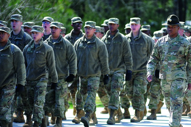 Sgt. 1st Class Jonathan Collier, Victor Company, 262nd Quartermaster Battalion, marches alongside QM School troops March 15.