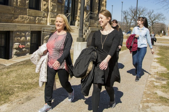 From left, Karen White and Kaylie Bowstead, both program specialists, G-1 (Human Resources), U.S. Army Sustainment Command, walk around the Rock Island Arsenal for the bi-weekly Fit Food Challenge walk, March 15. (Photo by Kevin Fleming, ASC Public Affairs)