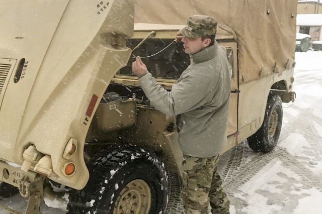 Staff Sgt. Robert Beard with the 3622nd Support Maintenance Company, 728th Combat Support Sustainment Battalion, 213th Regional Support Group, Pennsylvania Army National Guard, conducts preventive maintenance checks and services (PMCS) on his High Mobility Multipurpose Wheeled Vehicle (Humvee) in preparation for mission support during Winter Storm Toby March 21 in Spring City, Pa.