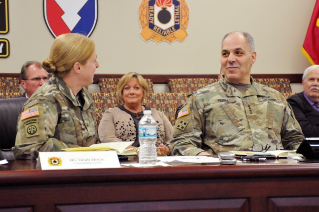 Brig. Gen. Heidi Hoyle, commander, Joint Munitions Command, leads an update for Gen. Gus Perna, commander, Army Materiel Command, during a visit to the Rock Island Arsenal, March 21.