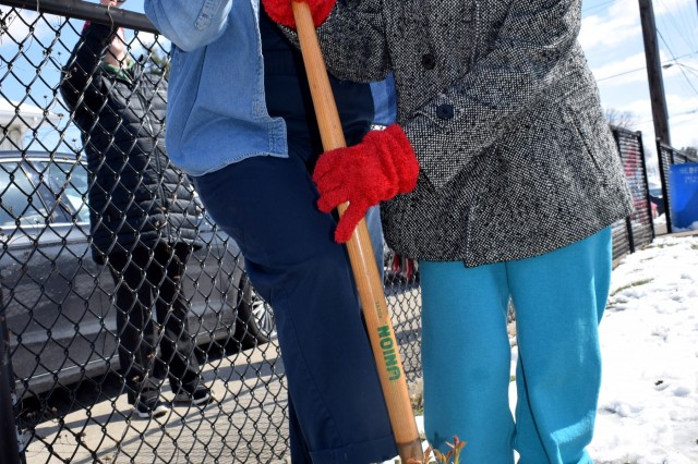 "Event coordinator Angie Timan (left) and former ""Rosie"" Smokey Cummings (right) break ground during a Rosie the Riveter Memorial Rose Garden Dedication Ceremony in Bedford, Ind., March 21. The rose bushes serve as part of a nationwide Living Memorial to honor the women who made history on the home front during World War II and inspire a new generation of Rosies."