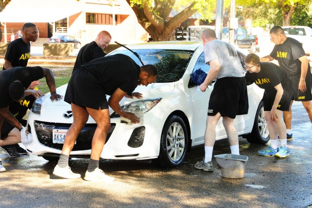 Warrant officer candidates of class 17-10 wash cars during the SHARP car wash last year to raise awareness to sexual assault prevention. This year's car wash is scheduled for March 31 from 8:30 a.m. to 3:30 p.m. on Shamrock Street.